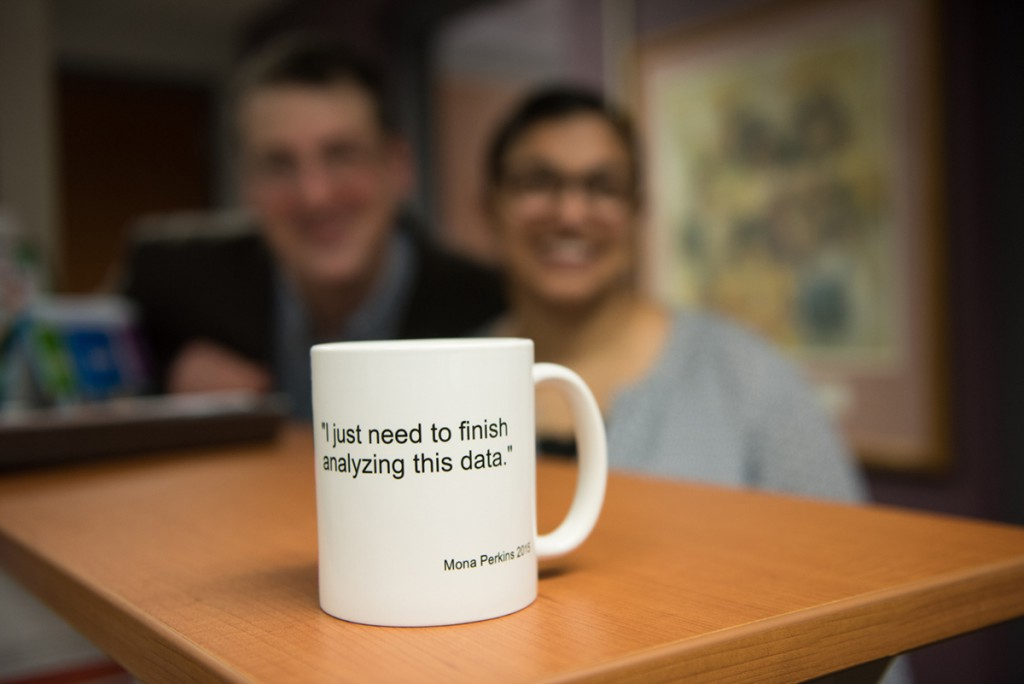 Customized coffee mug with Ted Christ and Mona Perkins in background