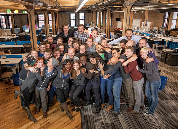 The Vidku team, including U students who followed Charlie Miller to take company roles, gathered for a photo in its new downtown Minneapolis home.