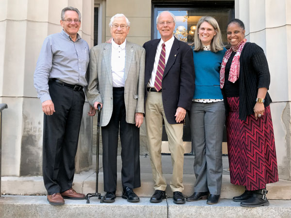 Photo of Paul Ramseth and his four committee members on the steps of the steps of Burton Hall.