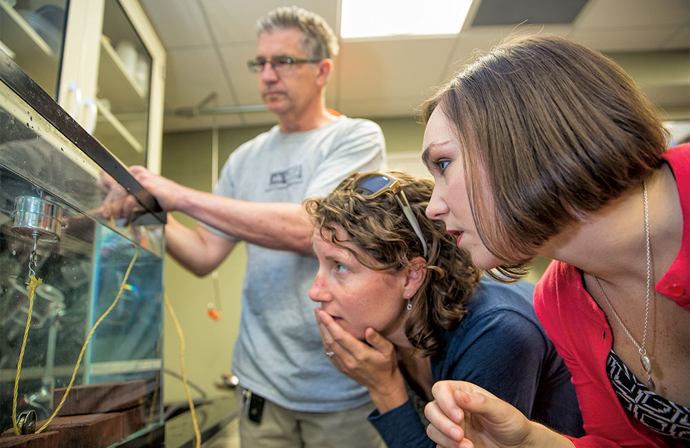 Emily Dare, right, worked with teachers Dave Rafferty and Liz Scheidel on a demonstration to teach students about buoyancy