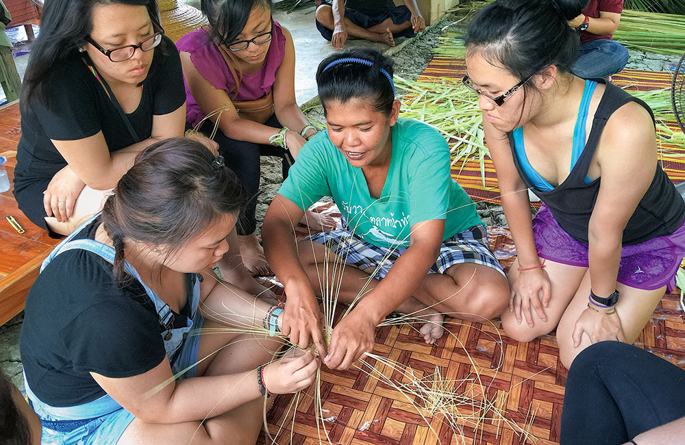 Students learn a weaving craft in Thailand
