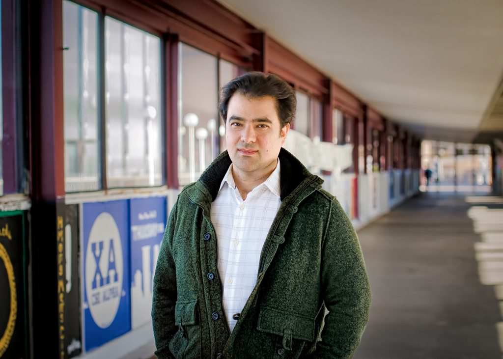 Photo: Professor Roozbeh Shirazi poses on the Washington Avenue Bridge.