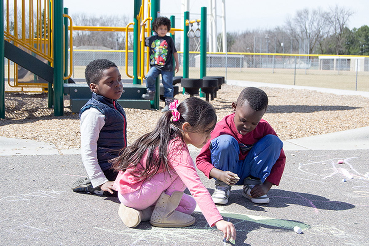 Robbinsdale preschool students play outside New Hope Learning Center.