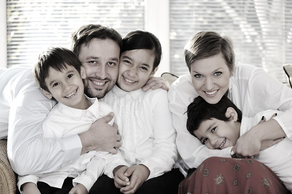 Happy family with kids on the couch