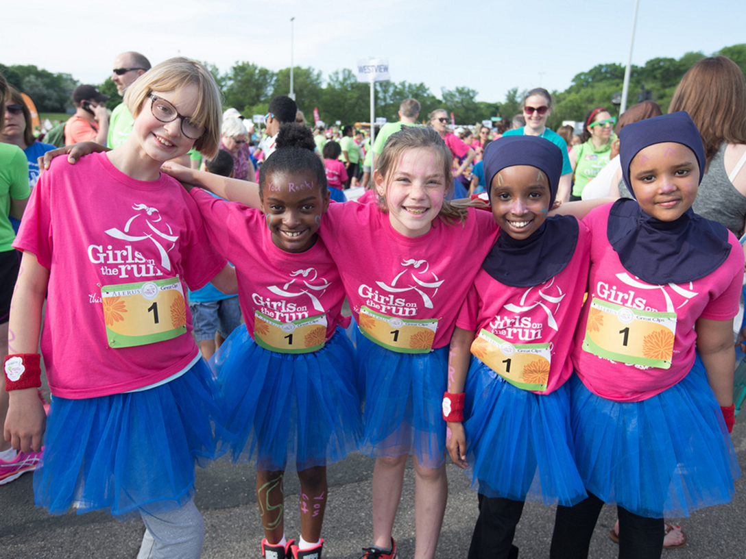 Girls on the Run Twin Cities participants pose during a local race.