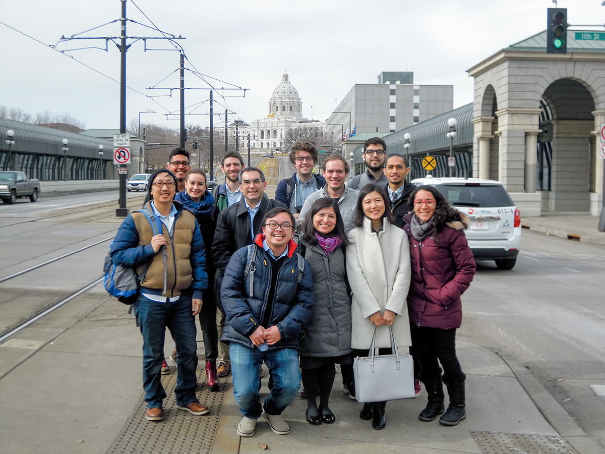 A group of students poses on the street near St. Paul's capitol building