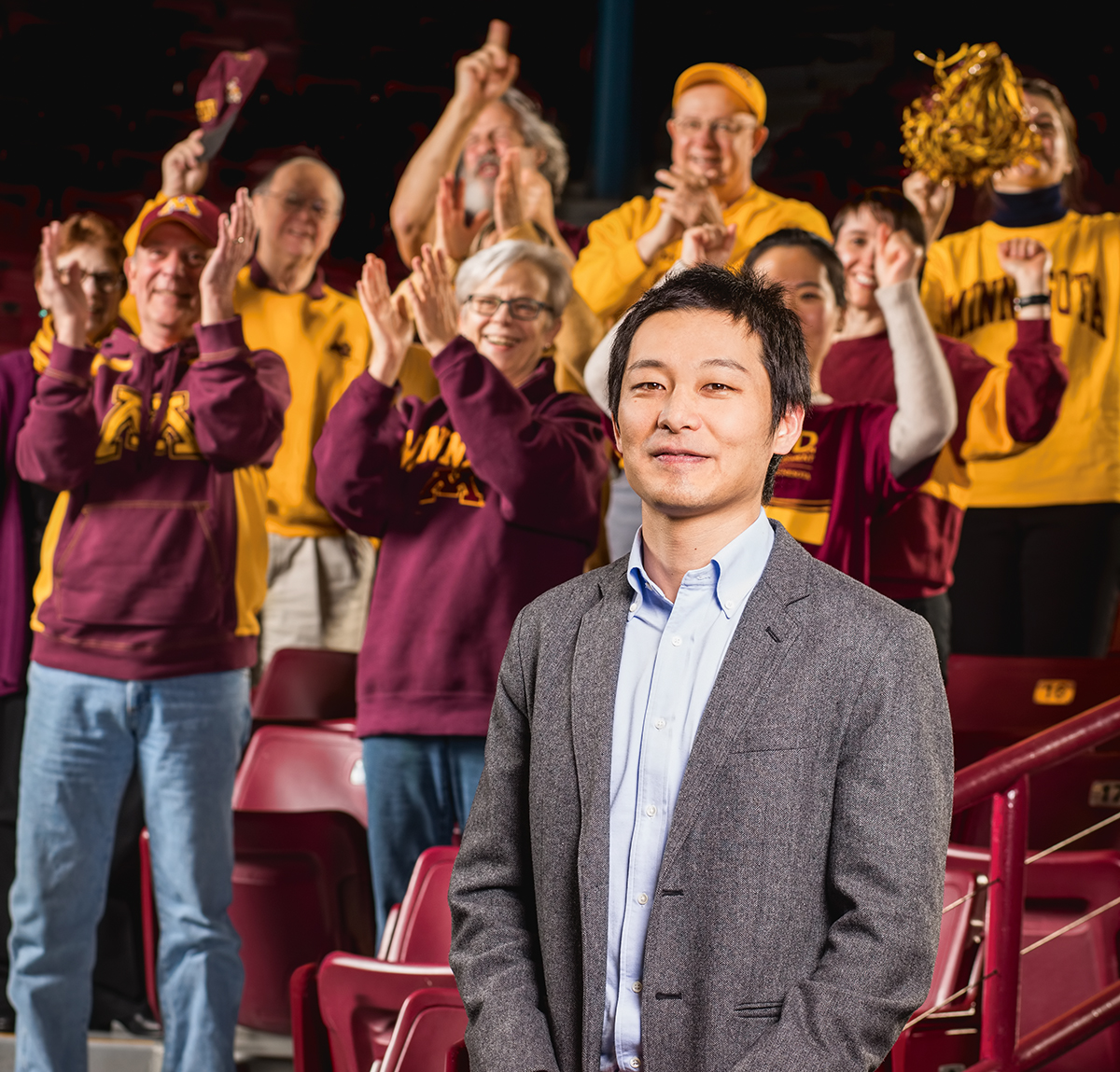 Professor Yuhei Inoue stands with fans wearing Gopher gear
