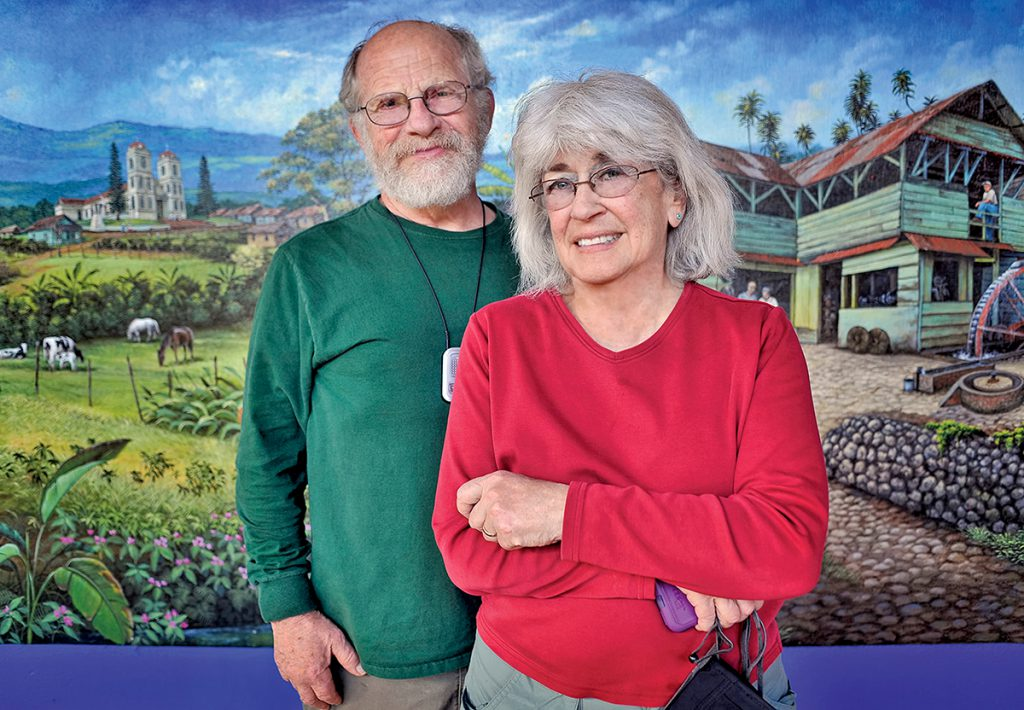 Mitch and Rachel Trockman pose in front of a mural.