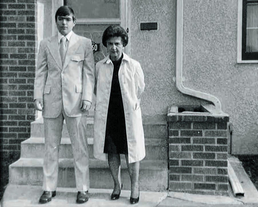 Young Jim Hansen and his mother posed on their front steps