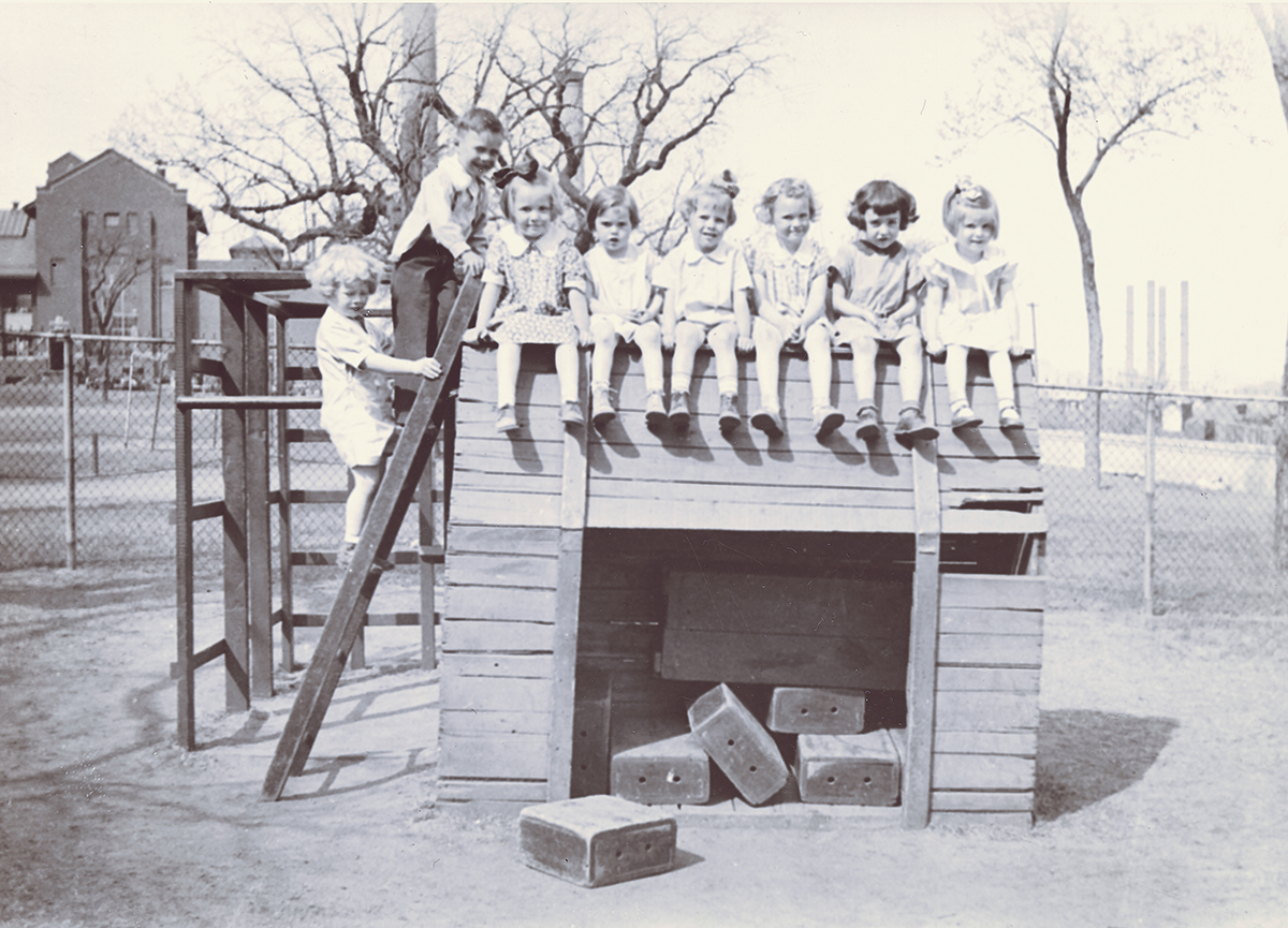 Black and white photo of children on a playground