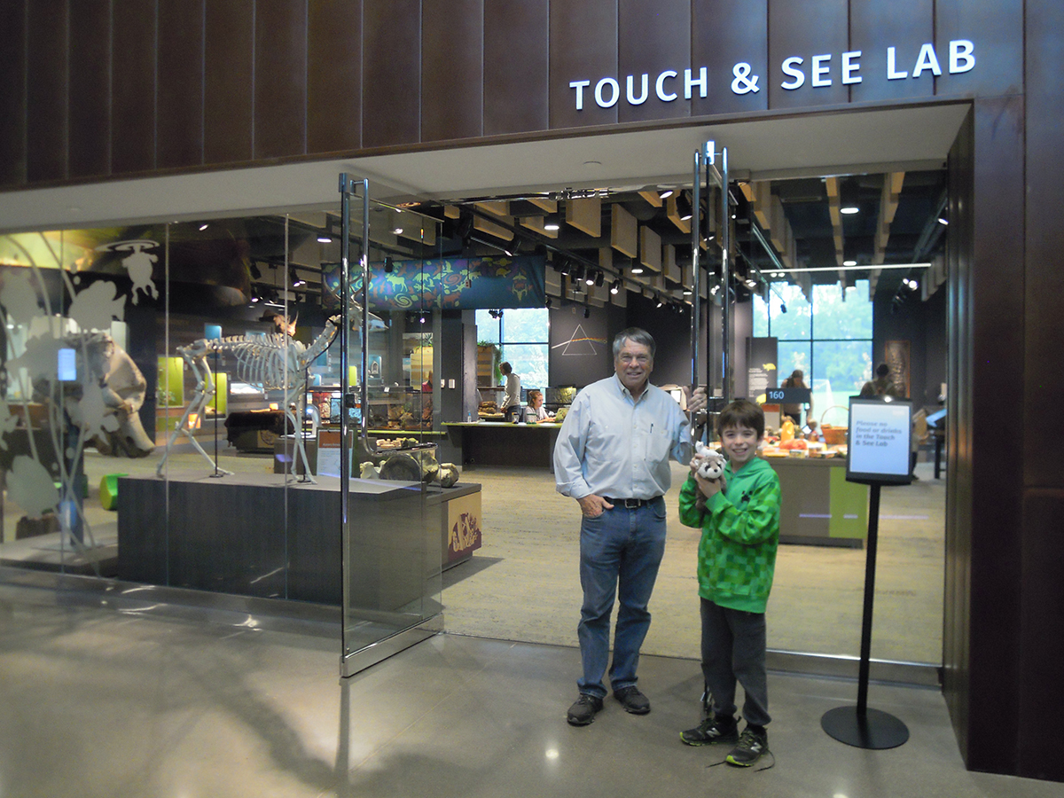 Roger Johnson and grandson outside of Bell Museum's Touch and See Lab