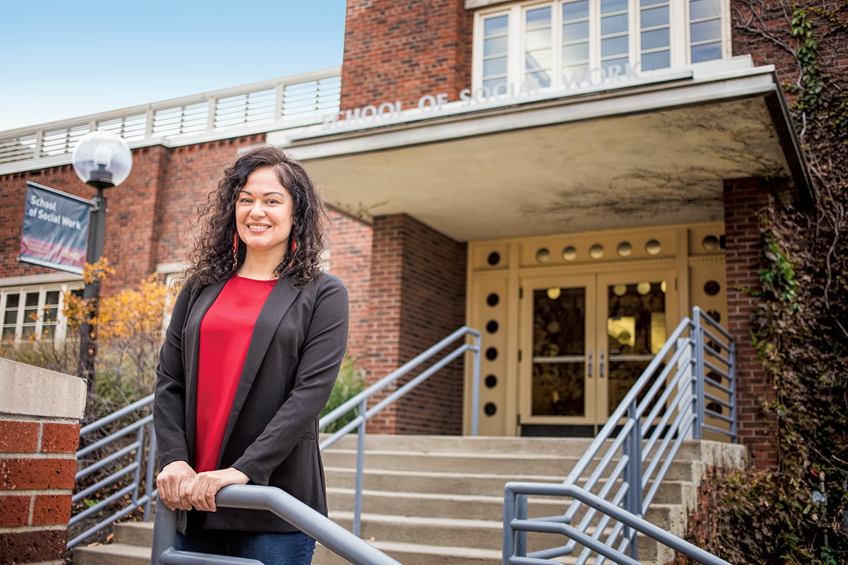 Photo of Cary Waubanascum on the steps of Peters Hall
