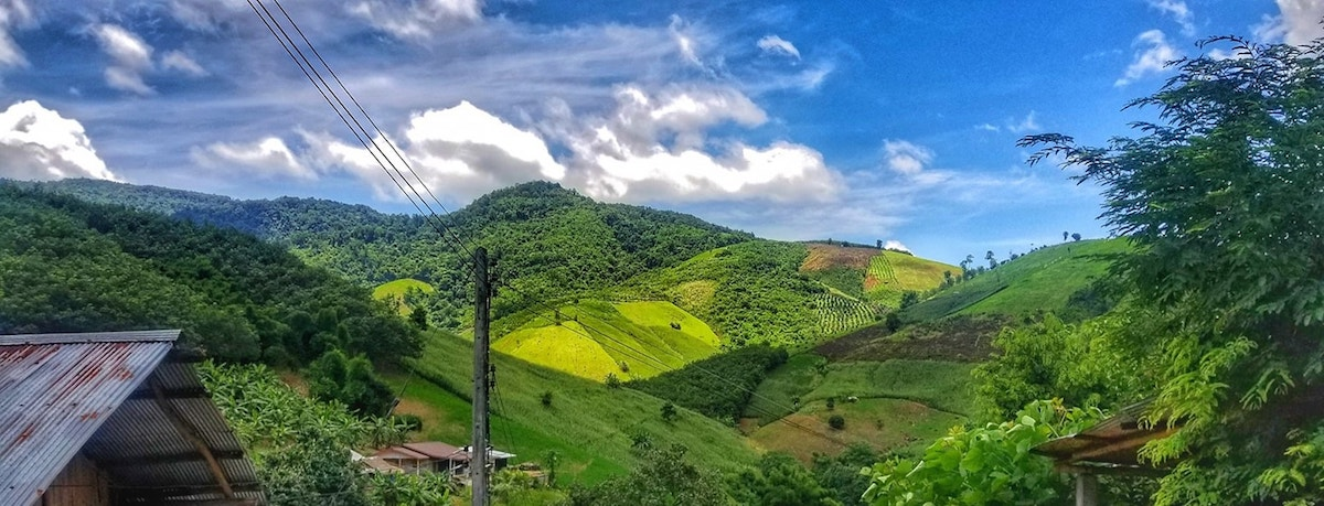 Photograph of green hilly landscape in Chiang Rai province, Thailand