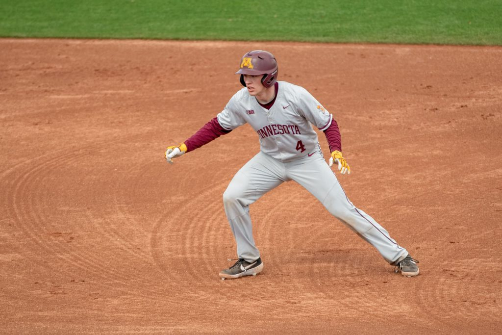 Gopher baseball player Eli Wilson leading off from a base