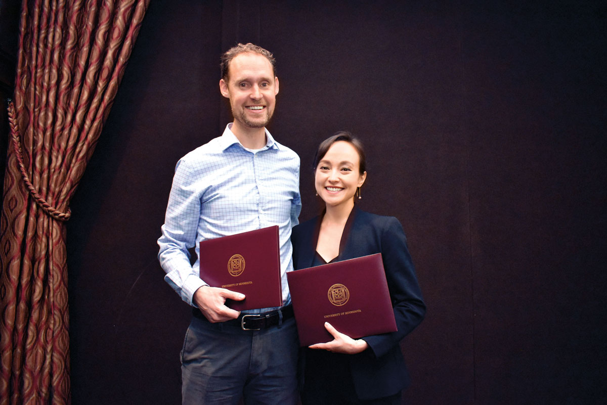 Rising Star faculty award recipient Tim Piehler, Department of Family Social Science, and graduate student award recipient Christina Zdawczyk,