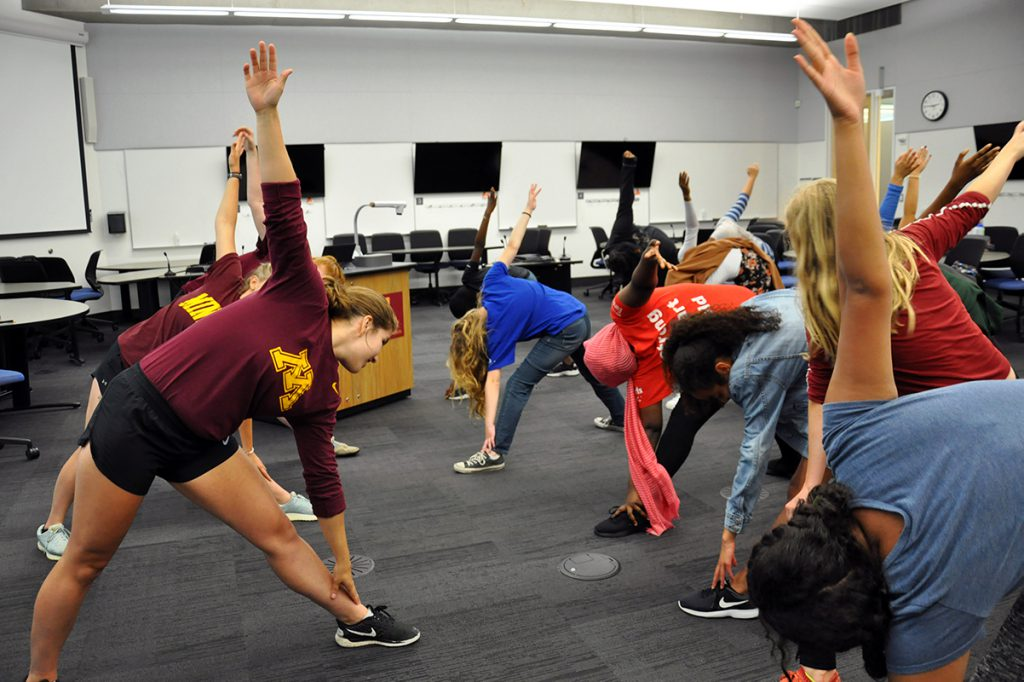 Group of UMN students stretching in a classroom