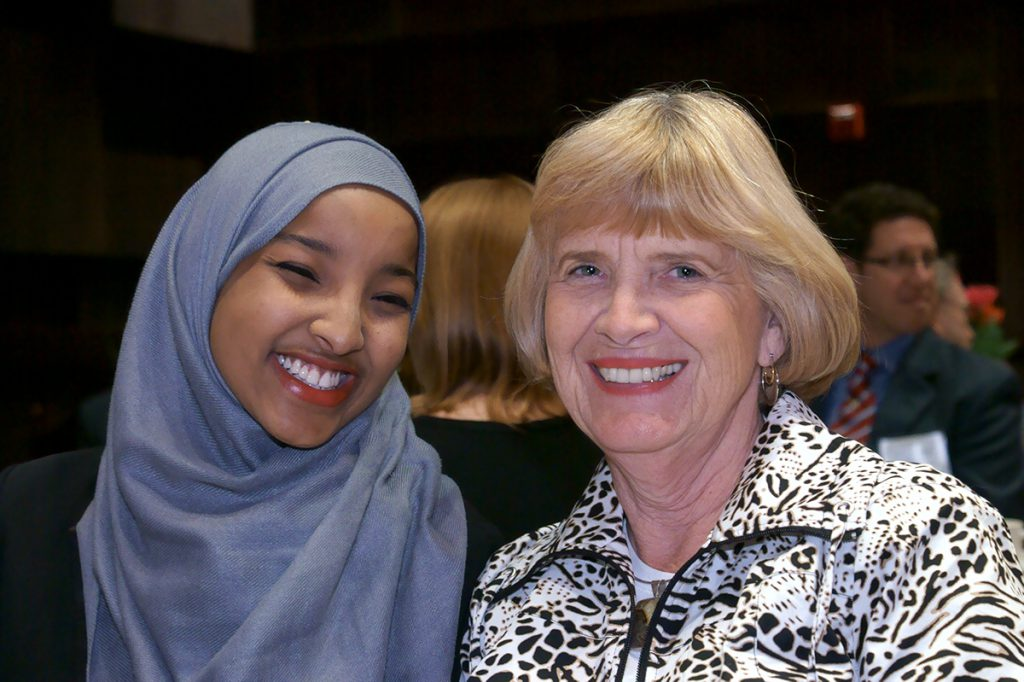 Veronica Johnson sitting with one of her scholarship recipients, Hafsa M. Mahad