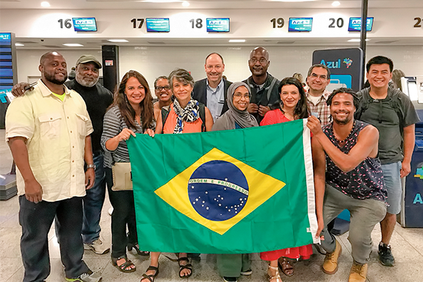 Michael C. Rodriguez and a group of other people with a Brazilian flag