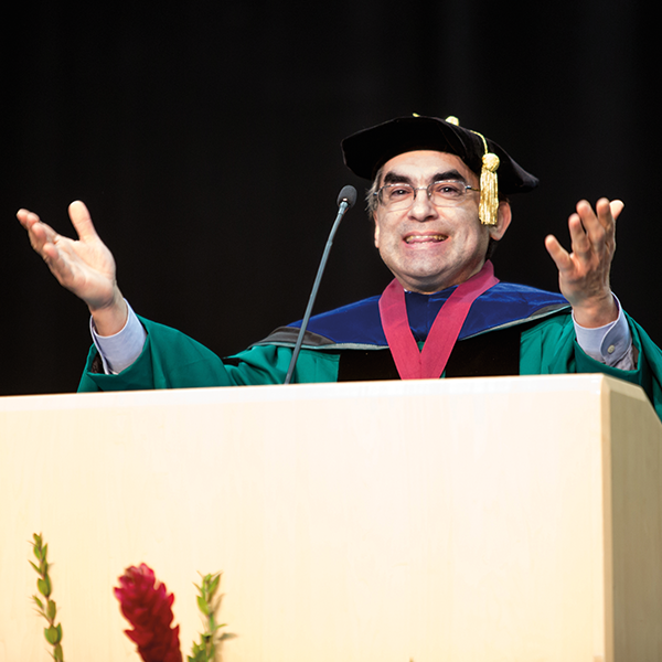 Michael C. Rodriguez giving the keynote address at a commencement ceremony