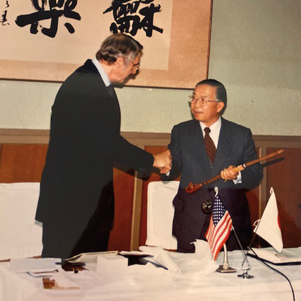 Dean William Gardner presenting a peace pipe to the Japanese